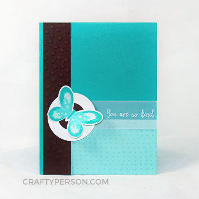 "Features the Watercolor Wings stamp set, Butterflies Framelits, Decorative Dots Textured Impressions Embossing Folder, 1-3/4"" & 1"" Circle Punches, White StazOn, Dazzling Details, Vellum Cardstock. Colors used: Bermuda Bay, Pool Party, Whisper White & Chocolate Chip"